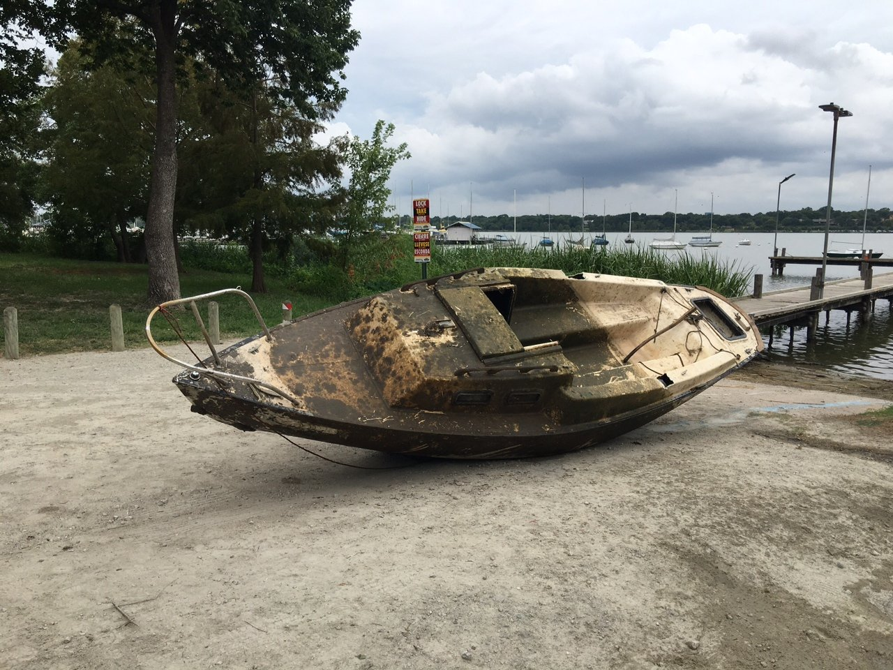 HDR Engineering Adopt-a_shoreline team worked hard to pull this abandoned, sunken boat from White Rock Lake.
